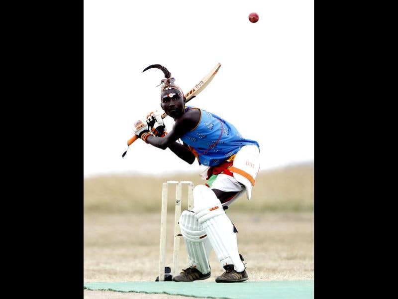 Thomas Takare of the Maasai Cricket Warriors plays a shot against the Ambassadors of Cricket from India during their Twenty20 cricket match in Ol Pejeta conservancy, in Laikipia national park. The Maasai Cricket Warriors are role models in their communities where they actively campaign against retrogressive and harmful cultural practices, such as female genital mutilation and early childhood marriages, while fighting to eradicate discrimination against women in Maasailand. Through cricket, they hope to promote healthier lifestyles and to also spread awareness about HIV/AIDS amongst youth. REUTERS