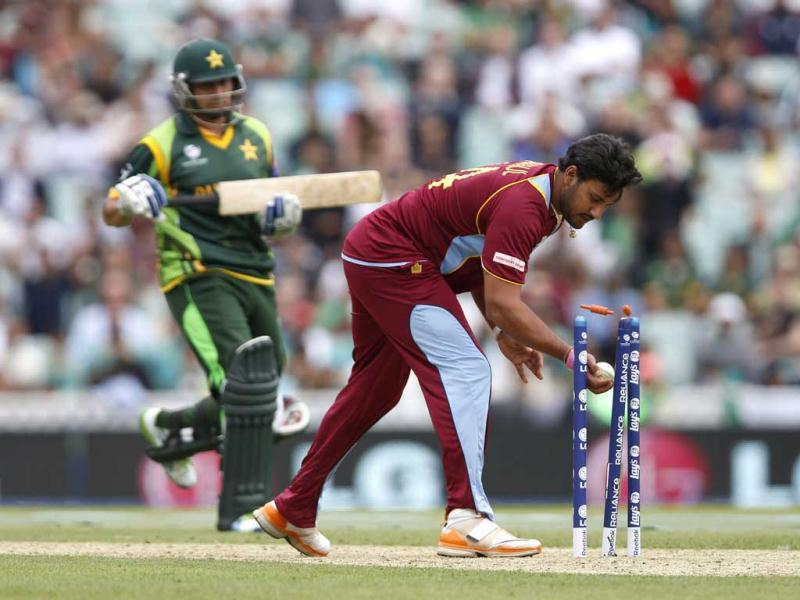 Ravindranath Rampaul runs out Pakistan's Saeed Ajmal, left, during their ICC Champions Trophy group B cricket match at the Oval cricket ground in London. (AP)