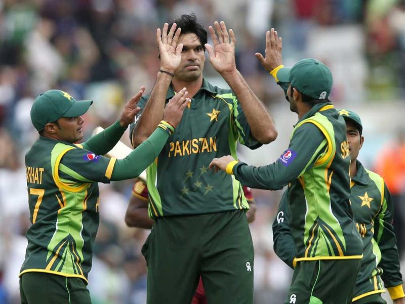 Muhammad Irfan, center, celebrates with teammates the wicket of West Indies' Johnson Charles caught by teammate Wahab Riaz during their ICC Champions Trophy group B cricket match at the Oval cricket ground in London. (AP)