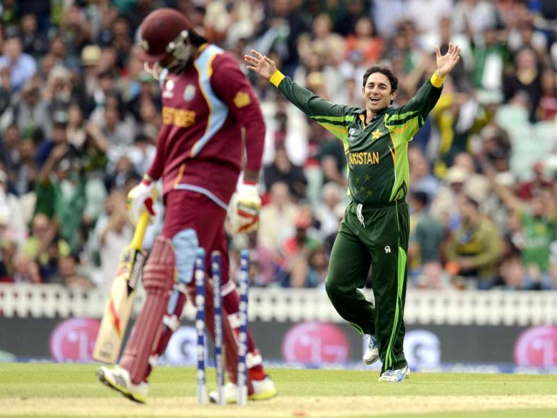 Saeed Ajmal celebrates after dismissing Chris Gayle (L) during the ICC Champions Trophy group B match at The Oval cricket ground in London. (Reuters)