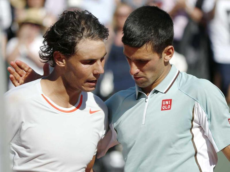 Spain's Rafael Nadal (L) embraces Serbia's Novak Djokovic after winning their French tennis Open semi final match at the Roland Garros stadium in Paris. AFP photo