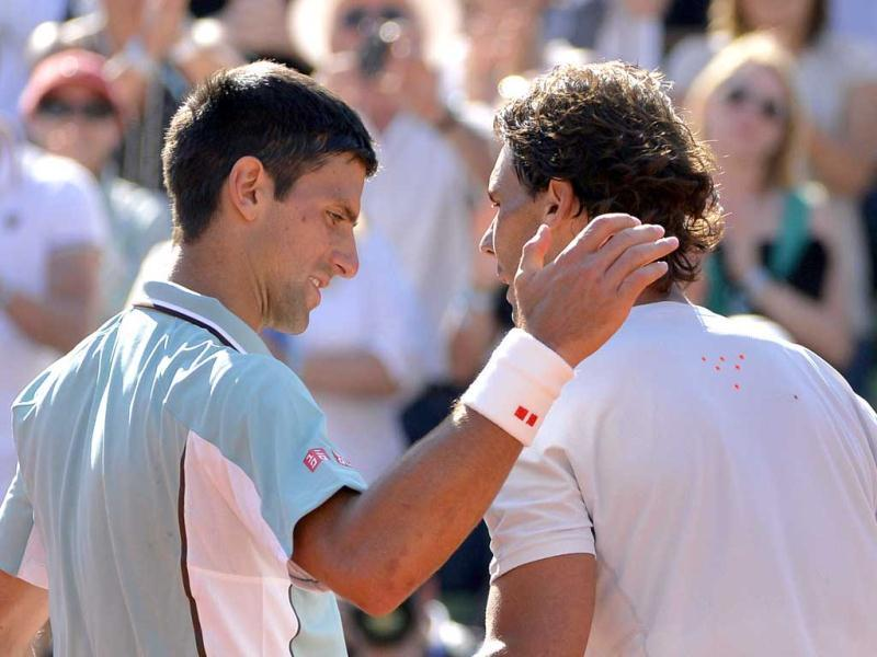 Spain's Rafael Nadal (R) shakes hands with Serbia's Novak Djokovic at the end of their French tennis Open semi-final match at the Roland Garros stadium in Paris. AFP
