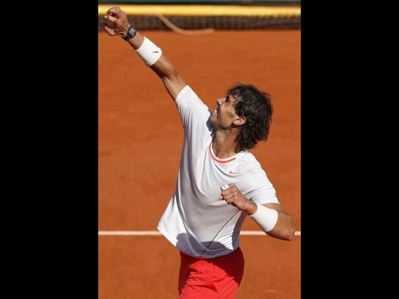 Spain's Rafael Nadal celebrates his victory over Serbia's Novak Djokovic at the end of their French tennis Open semi-final match at the Roland Garros stadium in Paris. AFP