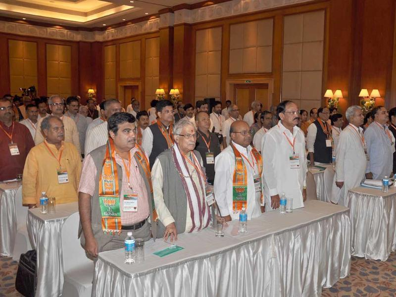 Senior BJP leaders Nitin Gadkari, Murli Manohar Joshi, Venkiah Naidu and others stand for the National Anthem during the inaugural session of the BJP National Executive Meeting in Goa on Friday. UNI Photo