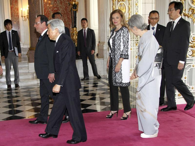 French President Francois Hollande and his companion Valerie Trierweiler walk with Japanese Emperor Akihito and Empress Michiko as they arrive to bid farewell to each other at the Akasaka Palace state guest house in Tokyo. Reuters