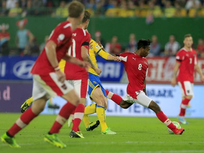 Austria's David Alaba (R) shoots the ball during the 2014 World Cup qualifying football match between Austria and Sweden at the Ernst Happel Stadium, in Vienna. AFP