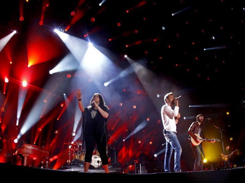 Lady Antebellum performs on day 2 of the 2013 CMA Music festival at the LP Field in Nashville. AP/Invision