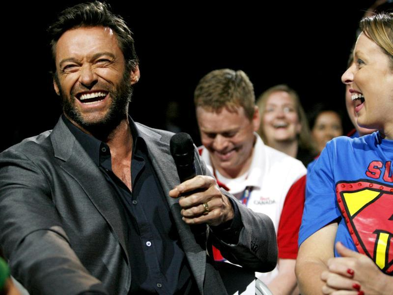 Event host Hugh Jackman talks to a shareholder in the crowd during the Walmart shareholders meeting in Fayetteville. AP