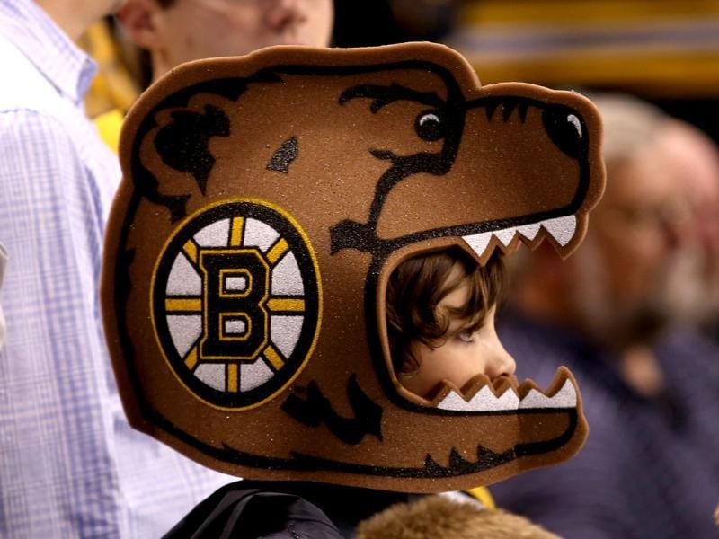 A young Boston Bruins fan looks on prior to Game Four of the Eastern Conference Final against the Pittsburgh Penguins during the 2013 NHL Stanley Cup Playoffs at the TD Garden in Boston. AFP/Getty Images