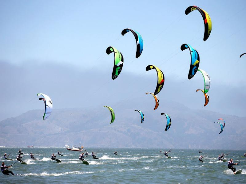 Athletes compete in a silver fleet race of the 2013 Kiteboard Racing North American Championship in the San Francisco Bay in San Francisco, California. AFP/Getty Images