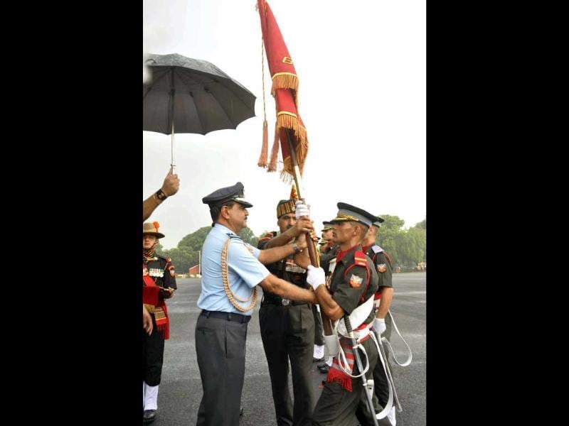 Air Chief Marshal NAK Browne presenting the banner to a cadet during the passing out parade at the Indian Military Academy in Dehradun. PTI Photo