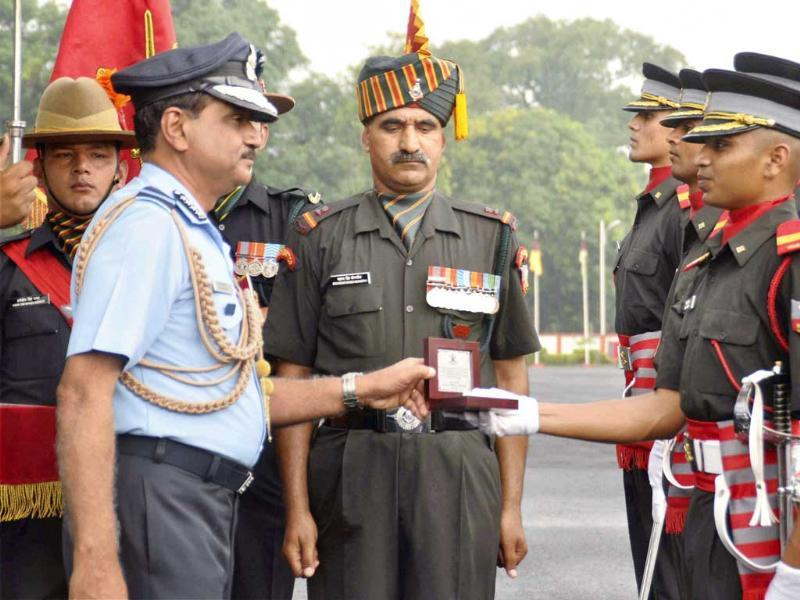 Air Chief Marshal NAK Browne presenting medal to a cadet during the passing out parade at the Indian Military Academy in Dehradun. PTI Photo
