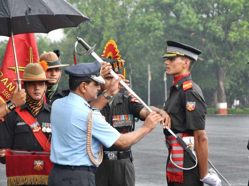 Air Chief Marshal NAK Browne presenting the sword of honour Sidhant Suhag during the passing out parade at the Indian Military Academy in Dehradun. PTI Photo