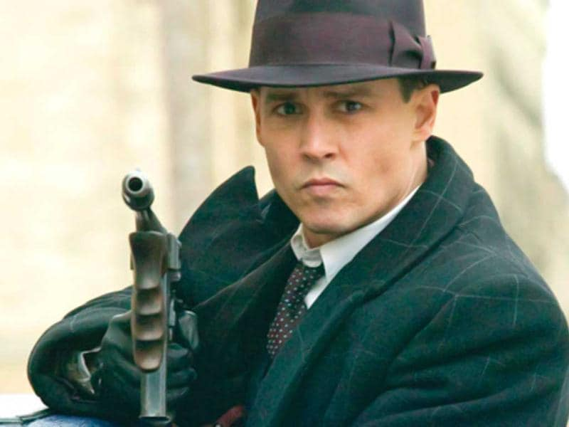 Depp dons the mafia suit for Public Enemies (2009)