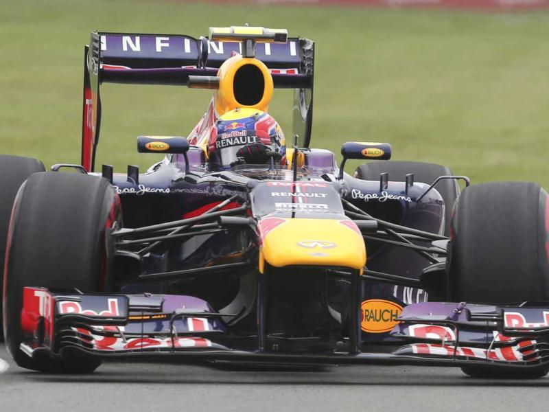 Red Bull driver Mark Webber of Australia steers his car during the third free practice at the Gilles Villeneuve racetrack, in Montreal, Canada. (AP)