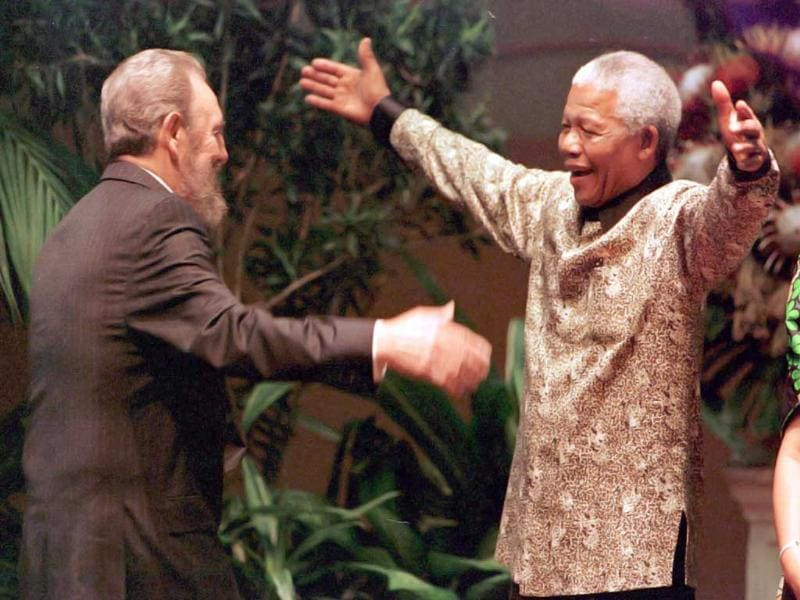 Former South African president Nelson Mandela greets Cuban leader Fidel Castro during the opening of the 12th Non-Aligned Movement summit in Durban on 2 September 1998. AFP files