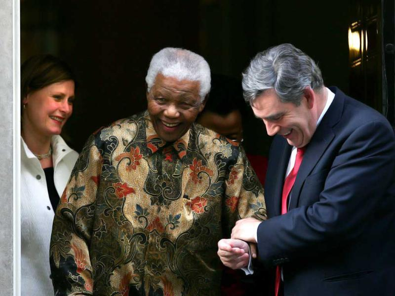 File photo: Former United Kingdom Prime Minister Gordon Brown helps Nelson Mandela, the former President of South Africa out of Ten Downing Street, on August 28, 2007 in London, England. Getty images/Cate Gillon