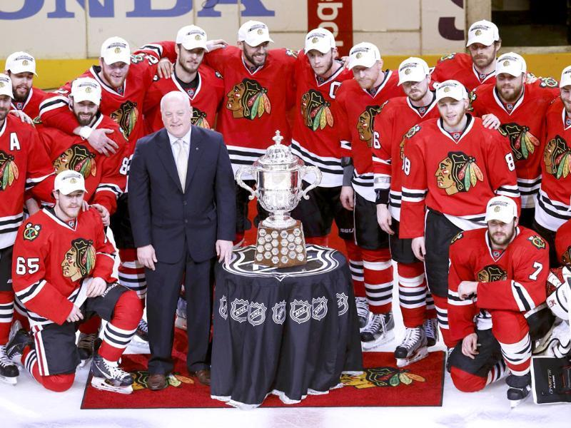 Members of the Chicago Blackhawks stand with the Clarence S Campbell Bowl and NHL Deputy Commissioner Bill Daly after they advanced to the Stanley Cup by defeating the Los Angeles Kings in Game 5 of their NHL Western Conference final hockey playoff series in Chicago, Illinois. Reuters