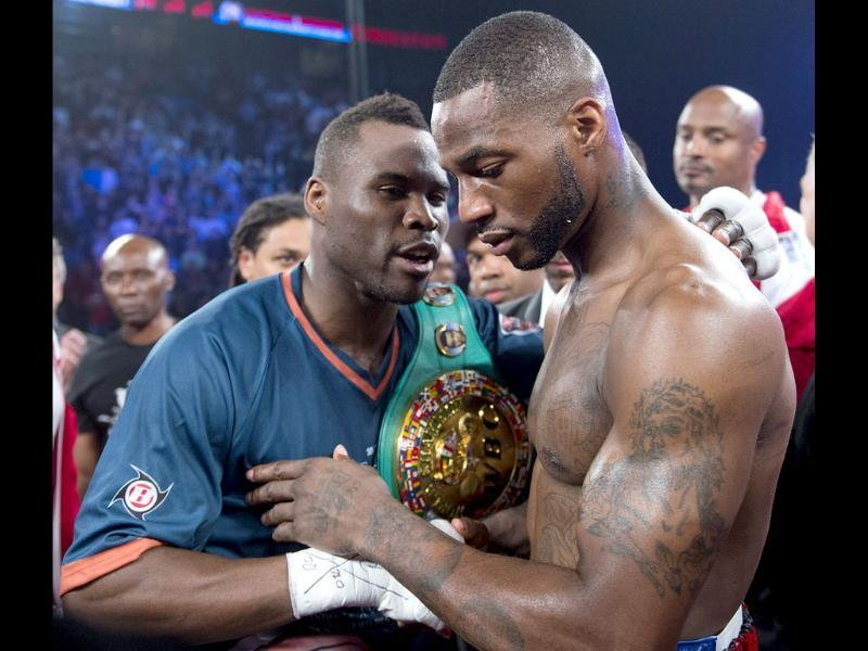 Chad Dawson from the United States, right, congratulates Adonis Stevenson from Canada after losing his WBC light-heavyweight championship title in round one of their bout in Montreal. AP