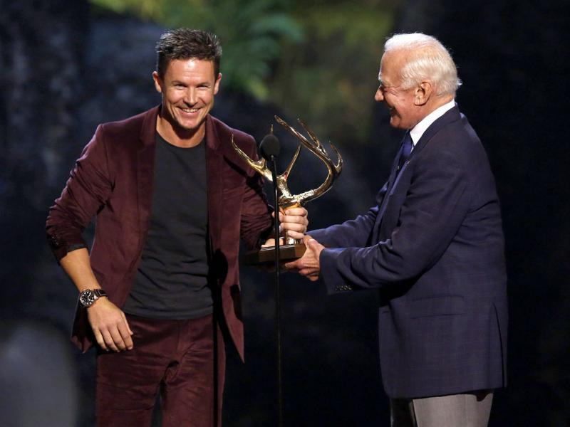 Former astronaut Buzz Aldrin presents skydiver Felix Baumgartner with the Mankind Award at the seventh annual Spike Tv's
