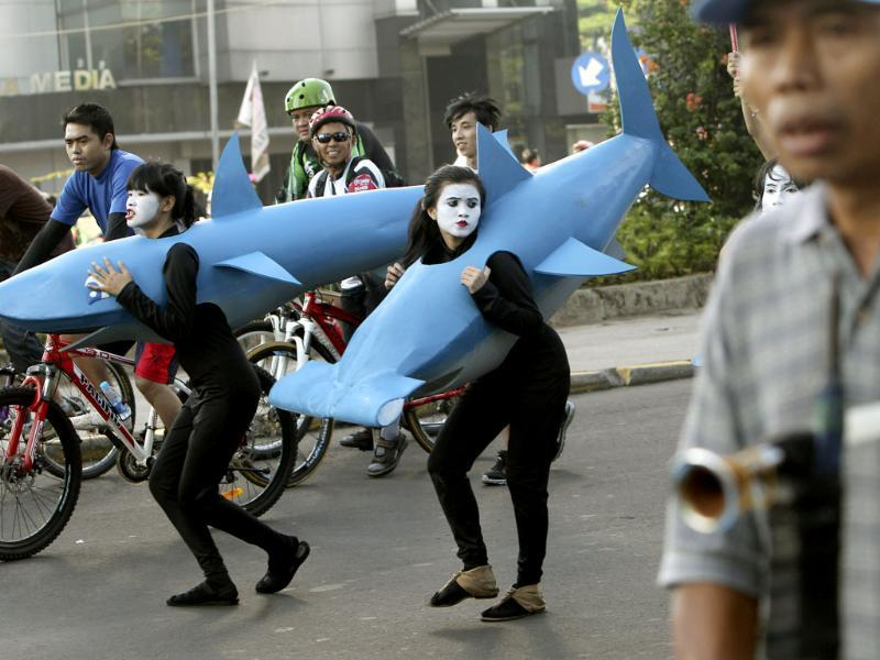 Activists wear shark costumes during a World Wildlife Fund rally against the slaughtering of sharks in Jakarta, Indonesia. AP