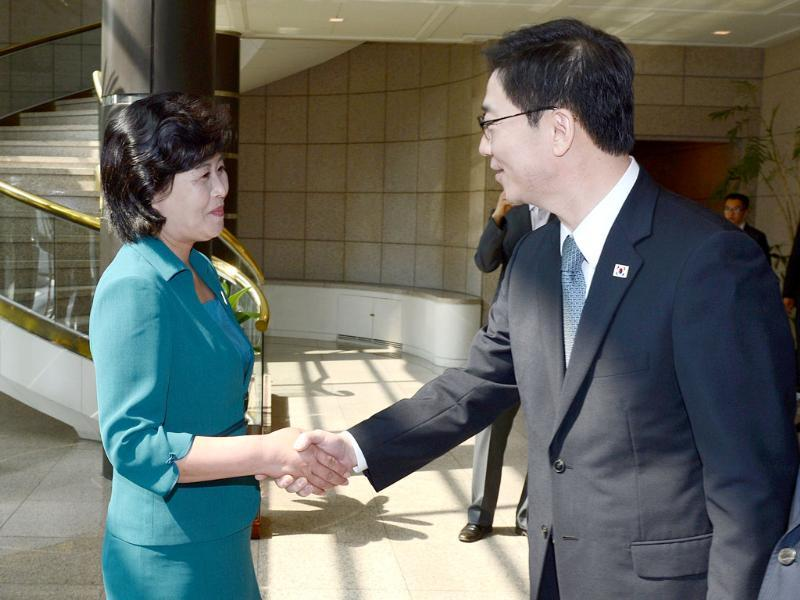 North Korean chief delegate Kim Song-Hye shakes hands with her South Korean counterpart Chun Hae-Sung before the inter-Korean working-level talks at the truce village of Panmunjom in the demilitarized zone dividing the two Koreas. AFP