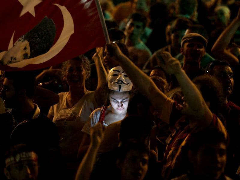 A protester uses her mobile phone during a demonstration at Taksim Square in Istanbul