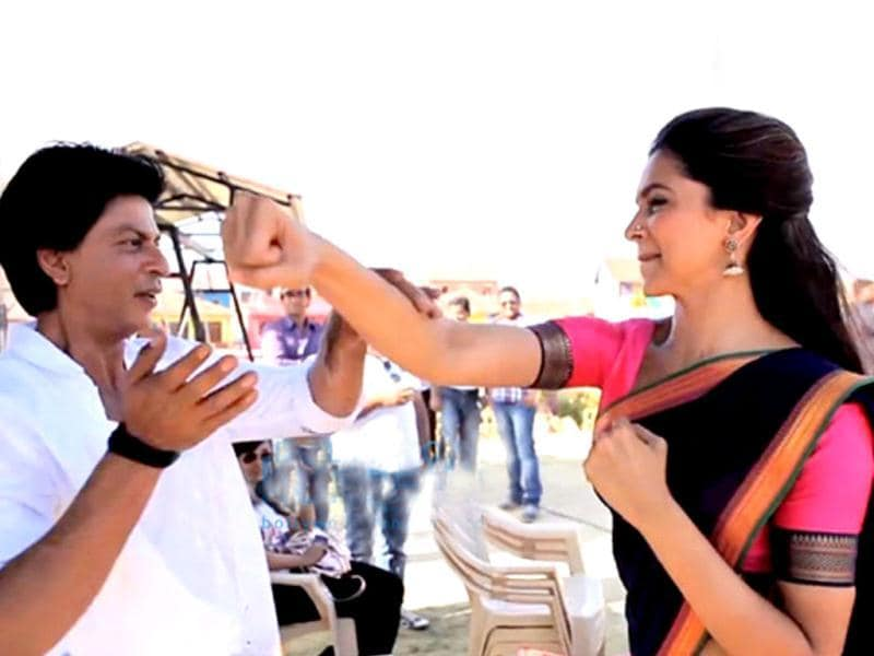 Deepika Padukone seen punching Shah Rukh Khan on the sets of Rohit Shetty's Chennai Express. The two share quite a few light moments during the shoot, check'em out!