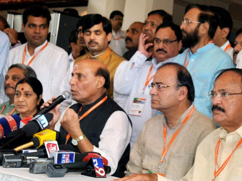 BJP president Rajnath Singh with party leaders speaks with Media after the BJP's meet in Panaji. PTI Photo