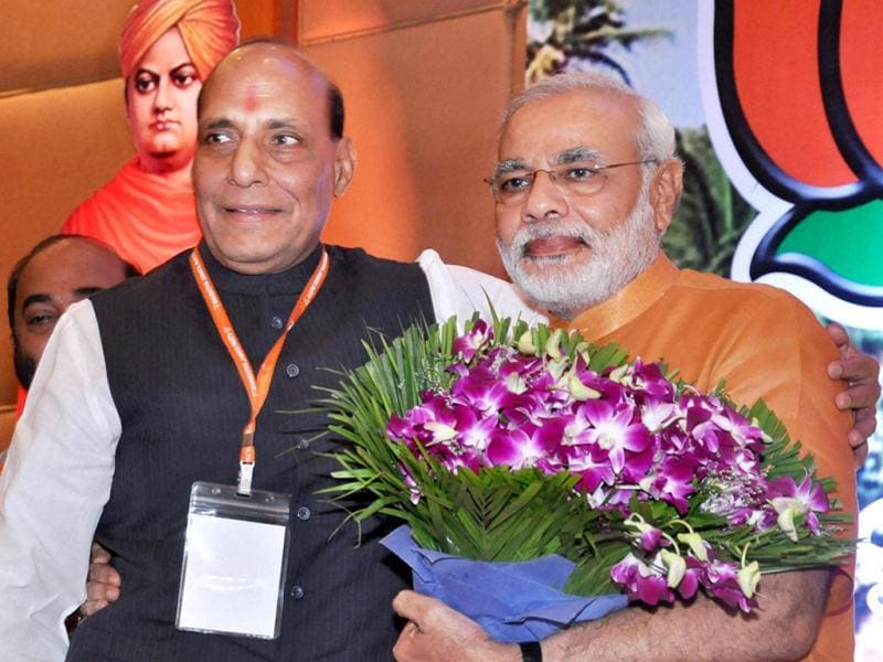 BJP president Rajnath Singh congratulates Narendra Modi after his anointment as chairman of BJP election campaign committee for 2014 polls in Panaji, Goa. PTI Photo