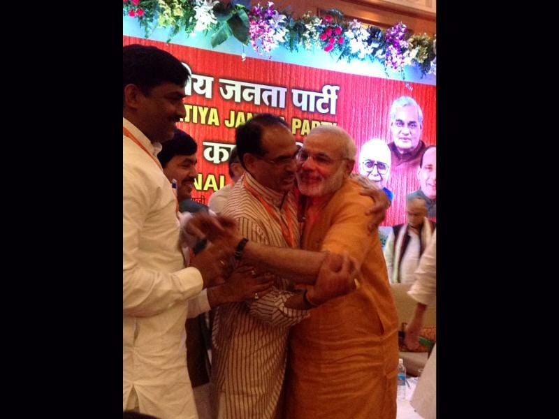 Gujarat CM Narendra Modi with Madhya Pradesh chief minister Shivraj Singh Chauhan after his anointment as BJP election campaign committee chief for 2014 polls. HT photo