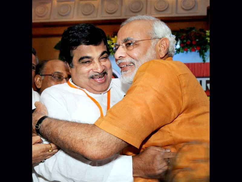 BJP strongman Narendra Modi being greeted by former BJP president Nitin Gadkari after being anointed chairman of BJP poll panel for 2014 polls. PTI