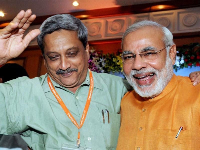 BJP poll panel chief Narendra Modi with Goa chief minister Manohar Parrikar at the party's National Executive meeting in Panaji, Goa. PTI Photo