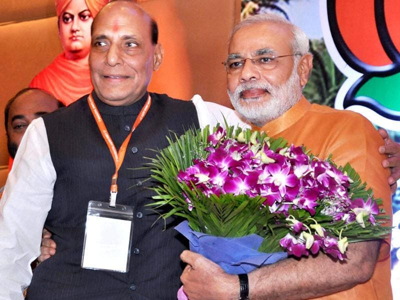 BJP president Rajnath Singh congratulates Narendra Modi after his anointment as chairman of BJP poll panel for 2014 elections in Panaji on Sunday. PTI Photo