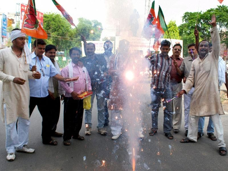 BJP workers celebrate with firecrackers after Narendra Modi's anointment as BJP poll panel chief in Allahabad. PTI Photo