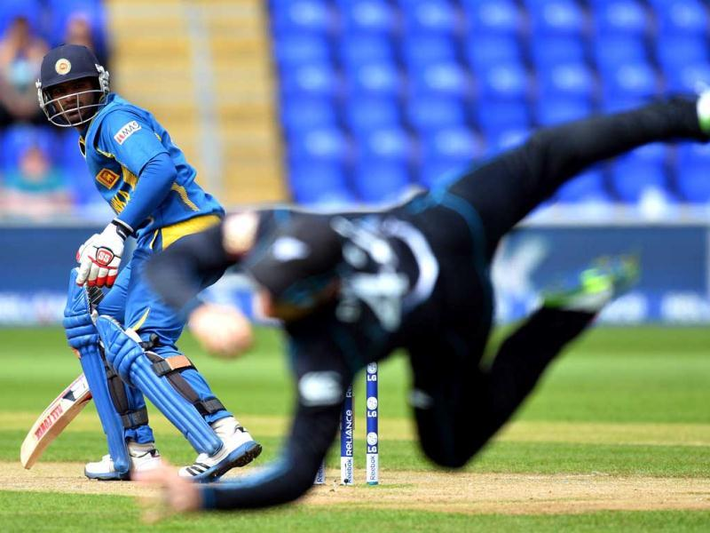 Nathan McCullum (R) catches Sri Lanka's Kusal Perera off the first ball during the 2013 ICC Champions Trophy cricket match between Sri Lanka and New Zealand at The Cardiff Wales Stadium in Cardiff, Wales. AFP