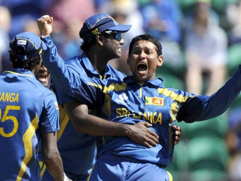 Tillakaratne Dilshan celebrates the dismissal of New Zealand's James Franklin during the ICC Champions Trophy group A cricket match at the Cardiff Wales Stadium, Cardiff. Reuters