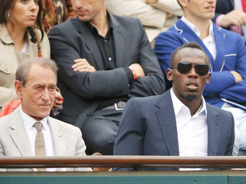 Jamaican sprinter Usain Bolt watch the men's singles final match between Rafael Nadal and David Ferrer at the French Open tennis tournament at the Roland Garros stadium in Paris. Reuters