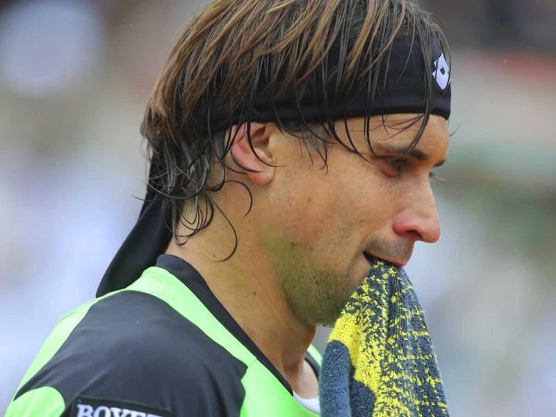 David Ferrer holds his towel in his match against compatriot Rafael Nadal in the final of the French Open tennis tournament, at Roland Garros stadium in Paris. AP Photo
