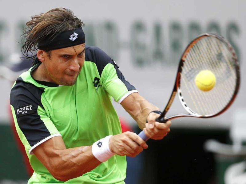 Spain's David Ferrer returns the ball to compatriot Rafael Nadal during the men's final match of the French Open tournament in Paris. AP Photo