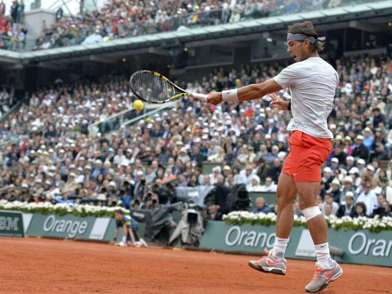 Rafael Nadal hits a forehand to David Ferrer during the 2013 French Open final at the Roland Garros stadium in Paris. AFP