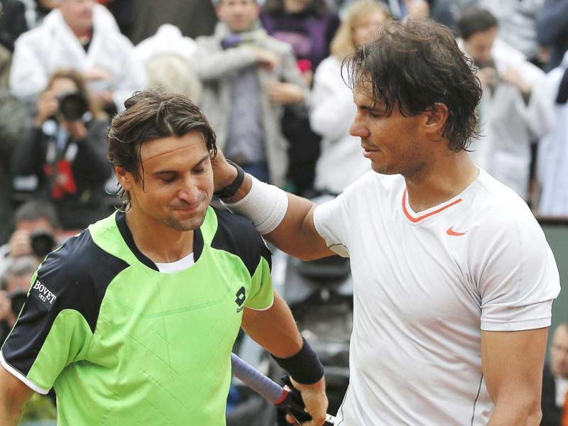 Rafael Nadal pats compatriot David Ferrer on the back after winning their men's singles final match at the French Open final in Paris. Reuters