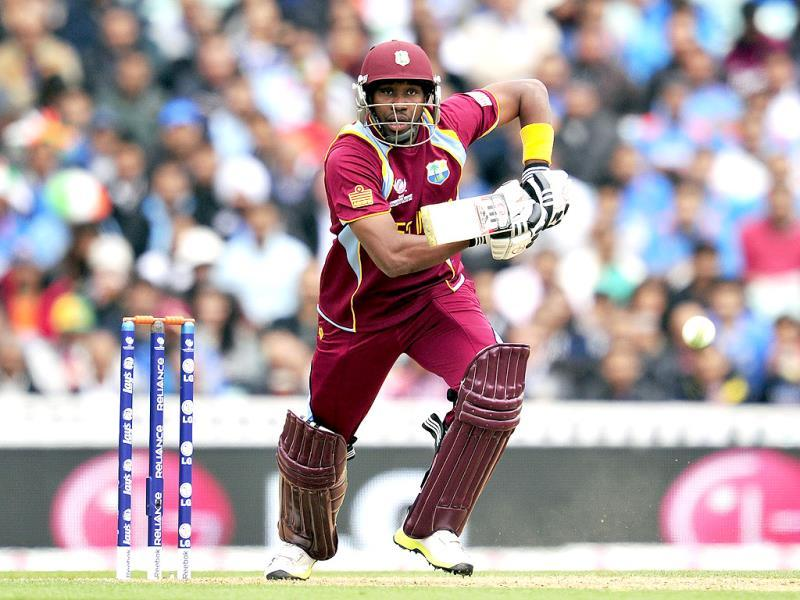 West Indies' Dwayne Bravo bats during the 2013 ICC Champions Trophy match between India and West Indies in London. AFP