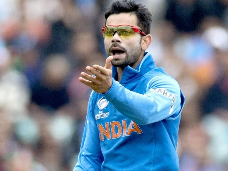 Virat Kohli reacts to the fielding of one of his teammates during the ICC Champions Trophy group B match with West Indies in London. AP