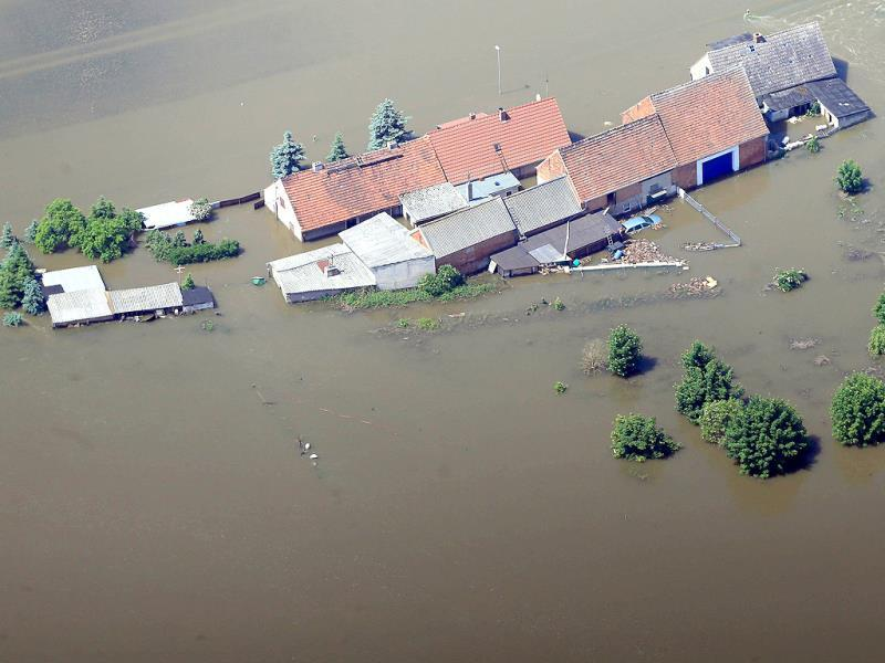 Aerial view shows houses submerging in the floodwaters of the river Elbe in Fischbeck, eastern Germany. Deadly floods forging a path of devastation through central Europe for more than a week bore down on northern Germany as troops raced to bolster sodden dykes. AFP
