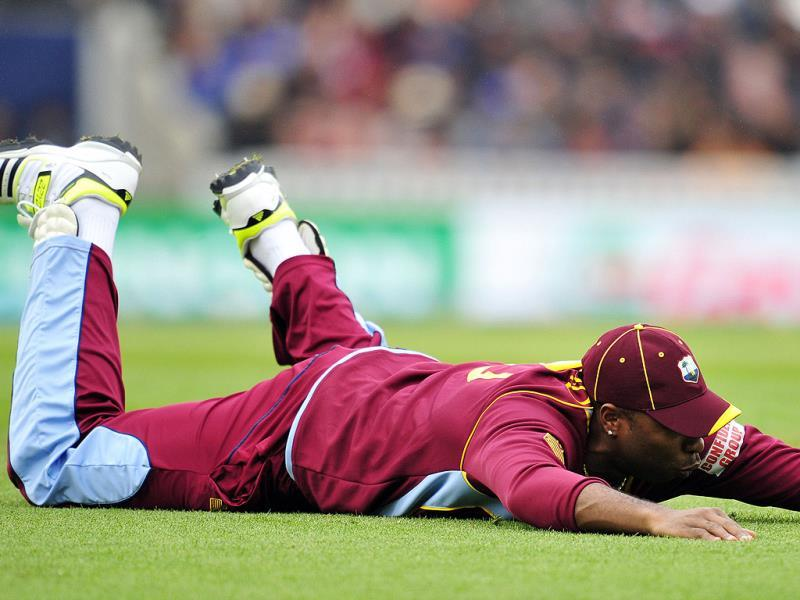 West Indies' Kemar Roach drops a catch during the Champions Trophy match between India and West Indies in London. AFP