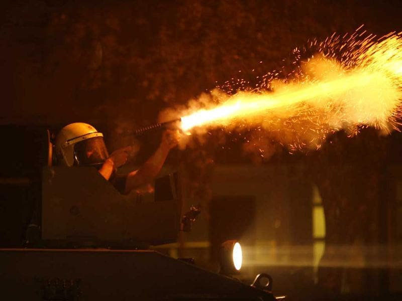 A riot police fires tear gas against anti-government protesters during clashes in Ankara. (Reuters)