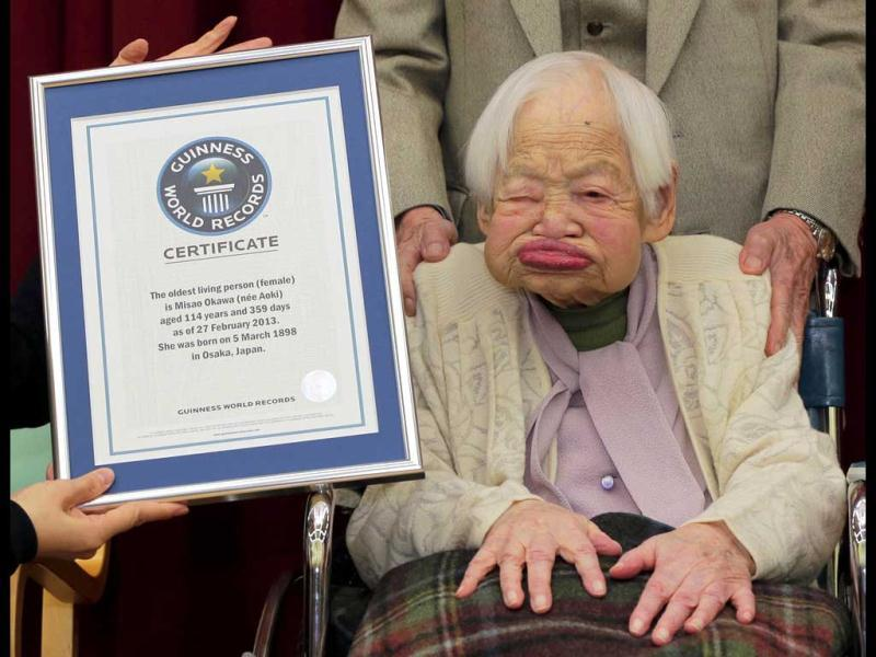 Japan's Misao Okawa poses with the certificate of the world's oldest woman, which was presented to her by Guinness World Records Japan Country Manager Erika Ogawa (unseen) at a nursing home in Osaka, western Japan.(AP file photo)