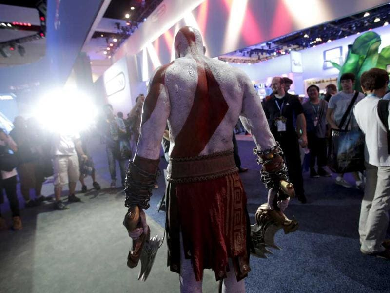 Kratos, a video game character from the God of Wa, poses for photos during the Electronic Entertainment Expo in Los Angeles. (AP)