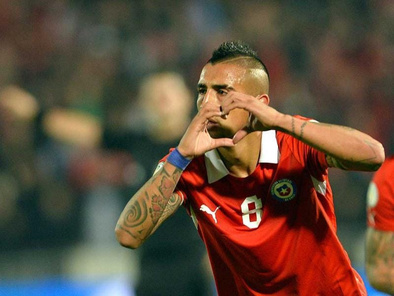 Chile's Arturo Vidal celebrates after scoring against Bolivia during their FIFA World Cup Brazil 2014 South American qualifying football match at Nacional stadium in Santiago. (AFP)
